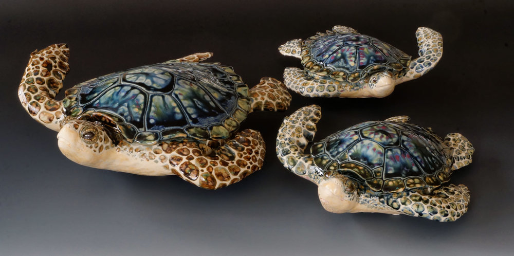 Freestanding turtles; 11, 12, and 16 inches long.