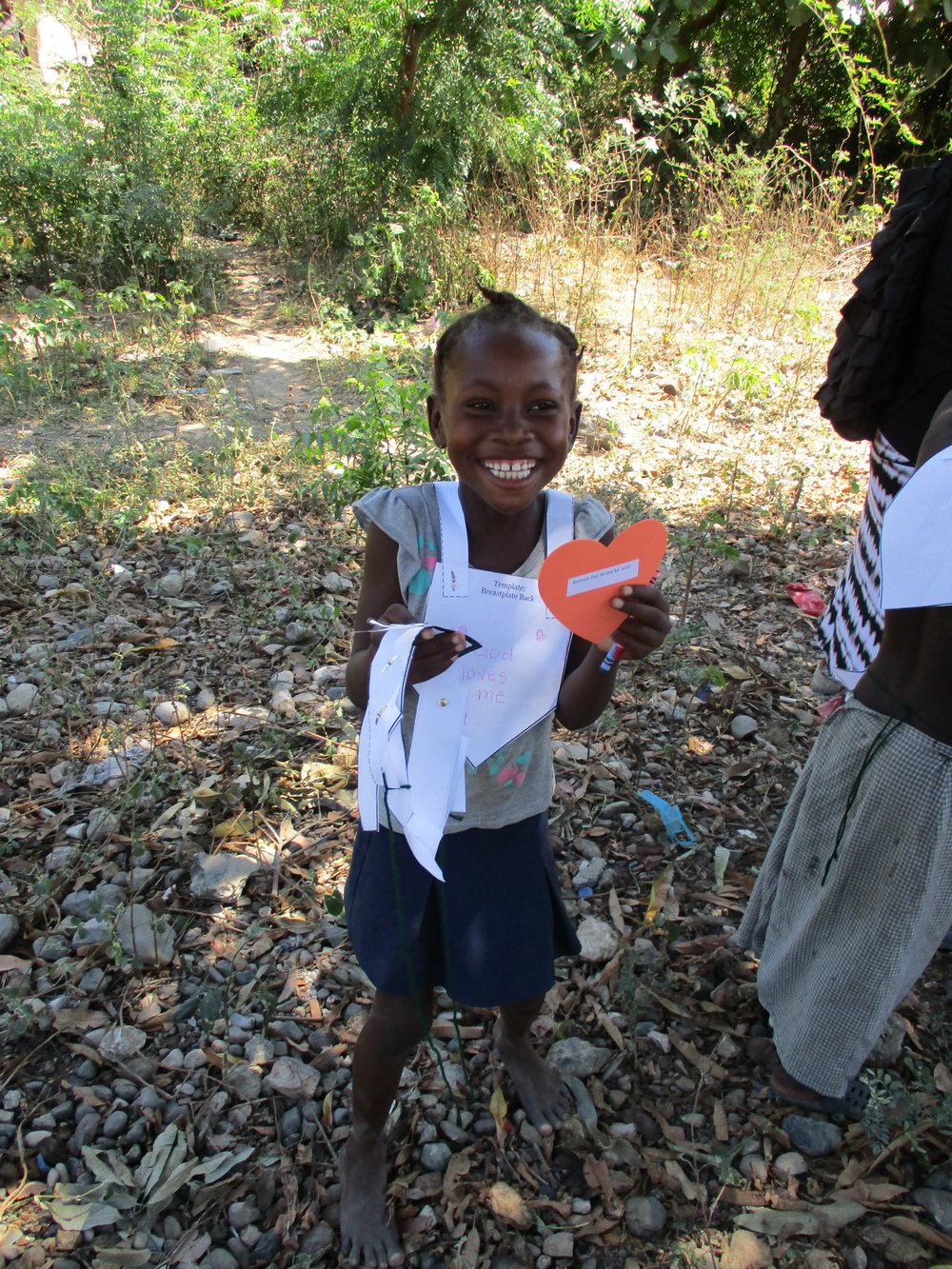 Little girl in Na Byen with her VBS activity - the Armor of God.