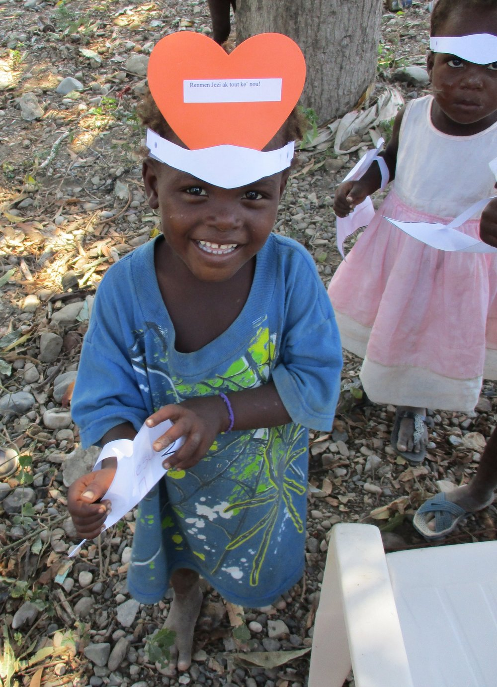 Little boy in Na Byen with his VBS crafts.