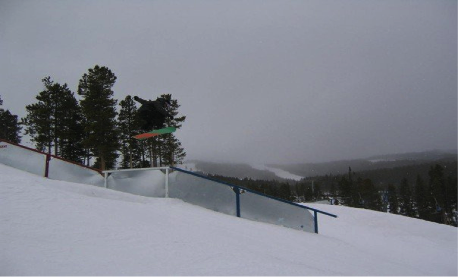 Shredshare team rider, Matt Weber, gap to boardslide in one of the Breck parks.