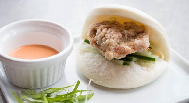 The karaage bao bun ($3) features fried chicken thigh meat and cucumbers, and is served with a sriracha mayo