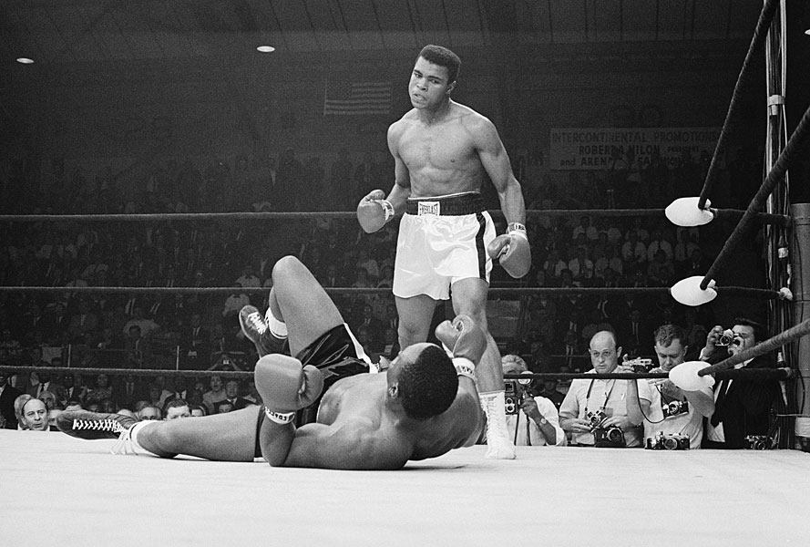 Ali knocks down Sonny Liston in rematch bout.
