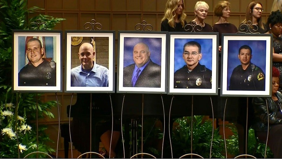 Five Dallas policers showed during Dallas Interfaith Memorial Service.