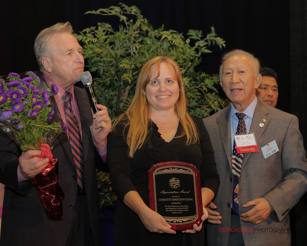 Charlotte Danielsson receiving award from CA State Senator Jim Nielsen and APAPA Founder CC Yin