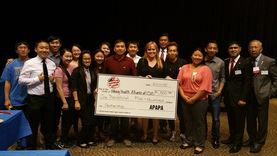 Charlotte Danielsson presenting scholarship check to the Hmong Student Association.