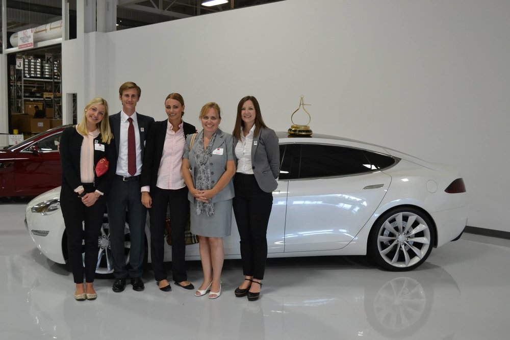 Charlotte Danielsson with her Swedish interns at Tesla event