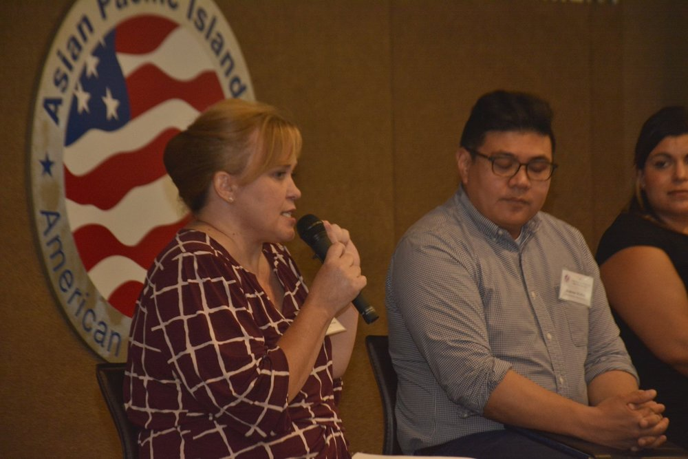 Charlotte Danielsson speaking on an immigration rights panel in 2017