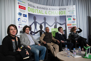 Tara moderating a panel with Muhammad Yunus in Paris, France.