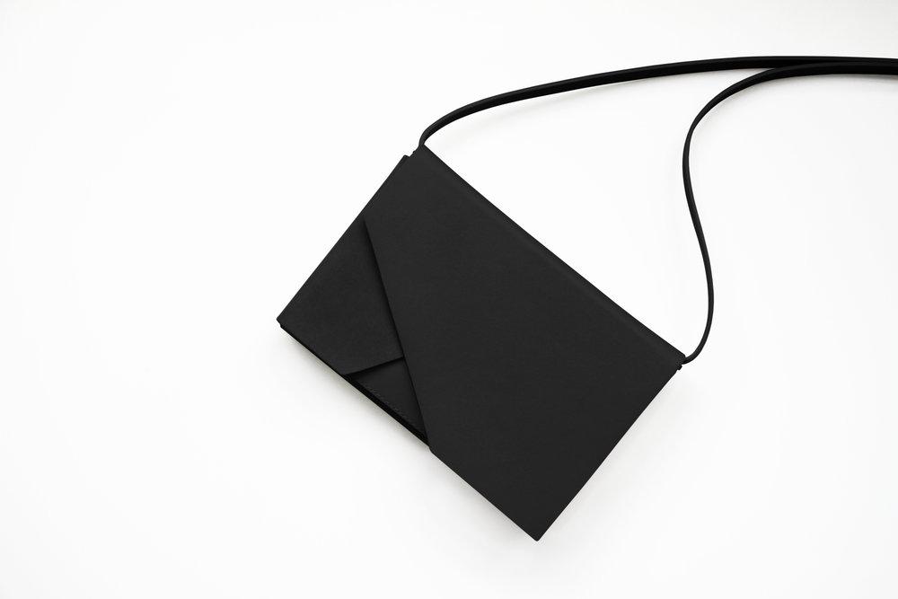Evo Leather Clutch Black Front 2 -Urban Travel x Isabel Wong V2.jpg