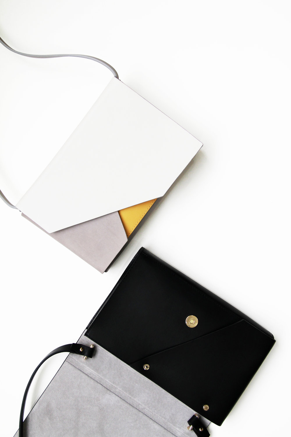 Evo Leather Clutch duo black and combo -Urban Travel x Isabel Wong V2.jpg