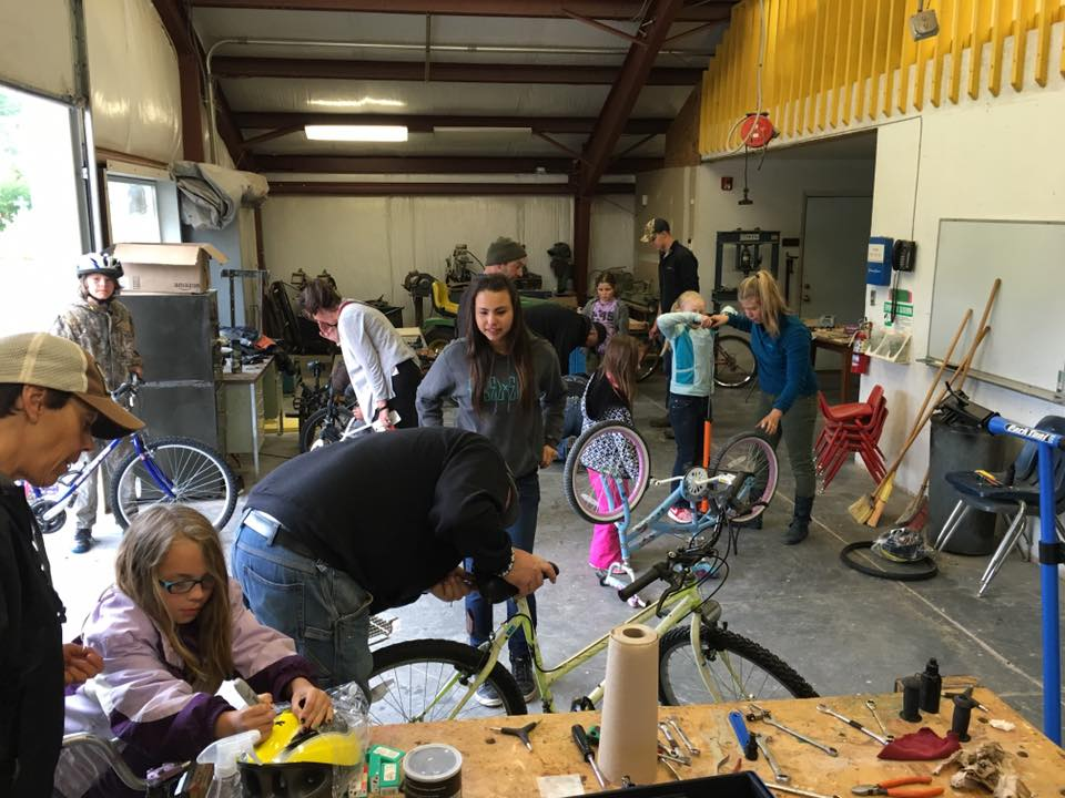 A shot of all of the tune-up action. This storage space that Dixon elementary had worked out very well for spreading out people, bikes, and tools. We provided the school with all the proper tools and a bike stand and from now on the kids can come in and maintain their bikes in this space.