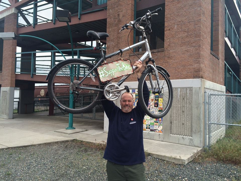 Mayor John Engen supporting the bike during Bike Month.