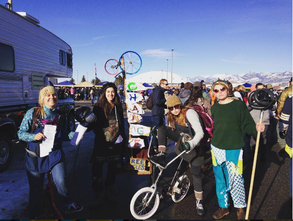 "The ""Change Gang"" campaigning via bucket drive and bicycle jousting in Bozeman."