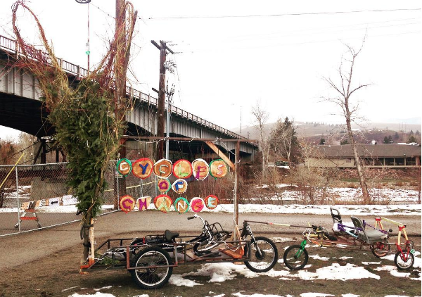 A Free Cycles outreach trailer used on National Winter Bike to Work Day, with a Valentine's Day touch. This gigantic heart was woven by the help of volunteers and interns.