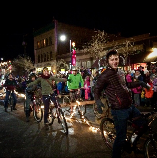 Free Cycles reindeer volunteers dragging the Cycles of Change trailer in the annual Parade of Lights.