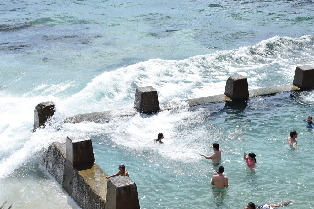 The surf crashing in at Ross Jones Memorial pool