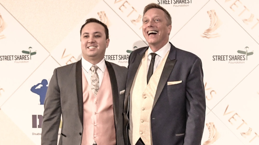 Todd Weiler and Husband   AUSV member and veteran, Todd Weiler, shows off his red carpet smile, alongside his gallant husband. The two fiercely represented the uniqueness and beauty of our military and veterans community. Mr. Weiler was a 4th Vettys nominee for the Employment Award.