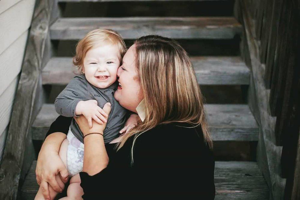 Mother laughing with baby. | Image by Documentary Family Photographer in Kansas City, Merry Ohler.