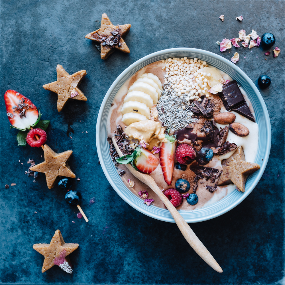 Top your smoothie bowl with your little peanut protein bites