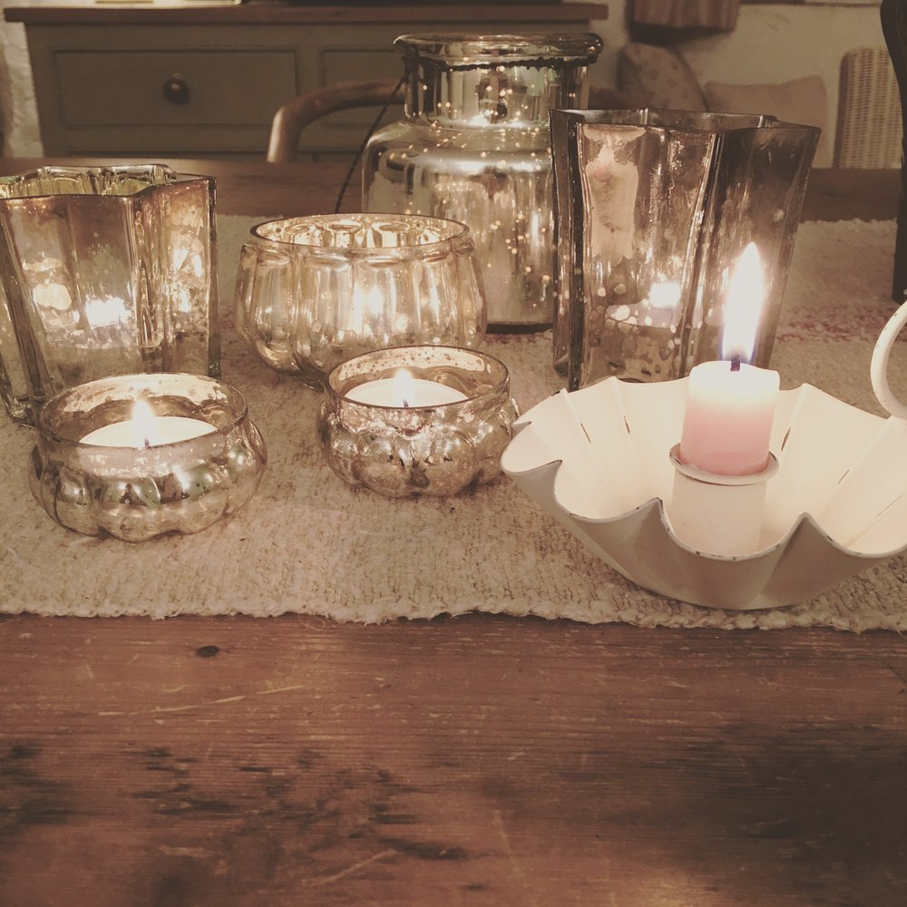 Pretty silvered glass votives and distressed metal chamber sticks coming to the brocante.