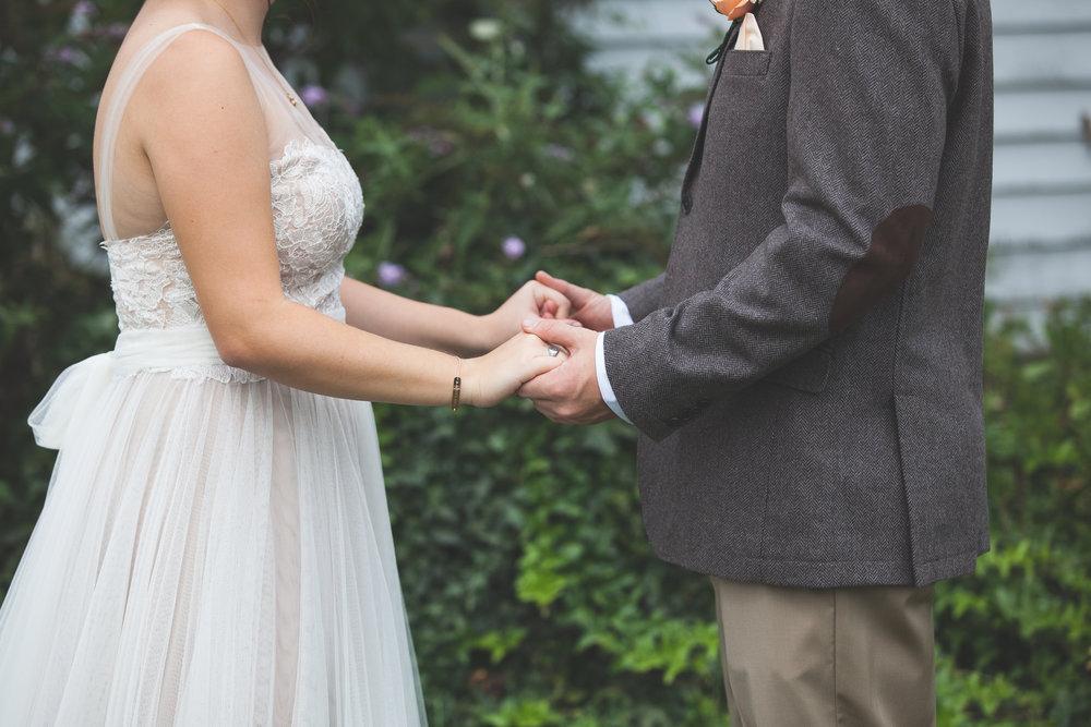 Danielle Salerno Photography First Look holding hands rbide and groom latitude longitude coordinates bracelet