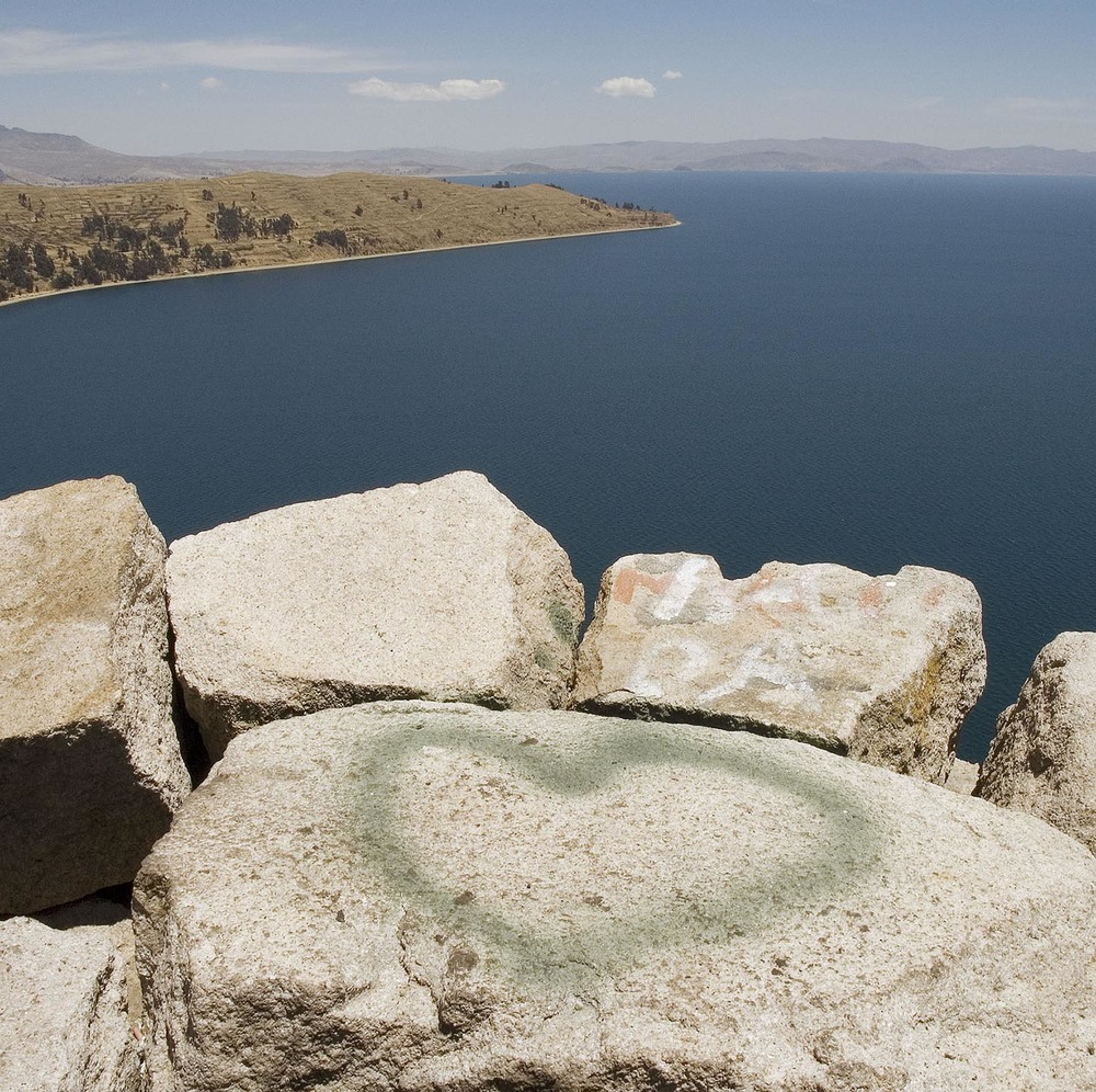 "On the shores of Lake Titicaca in Bolivia lies the town of Copacabana. Nestled high above it I found this heart next to the ""Stations of the Seven Sorrows of Mary""."