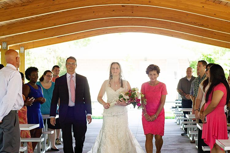 covington-virginia-wedding-photographers-bride-walking-down-aisle-parents