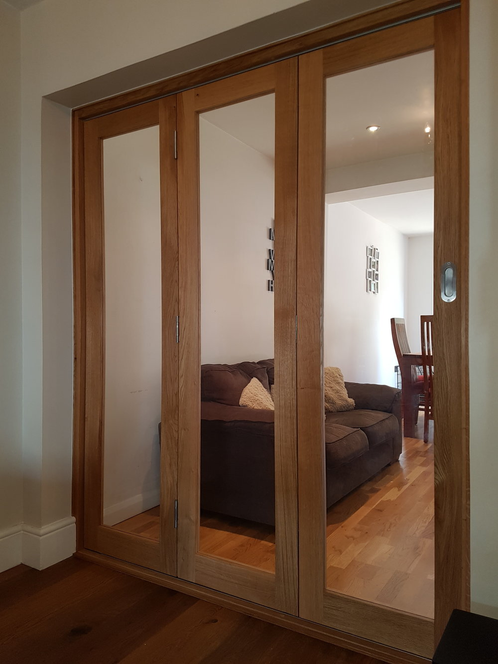 Oak bi-fold doors closed.jpg