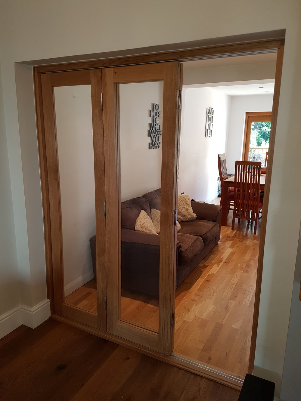 Oak bi-fold doors partial open.jpg