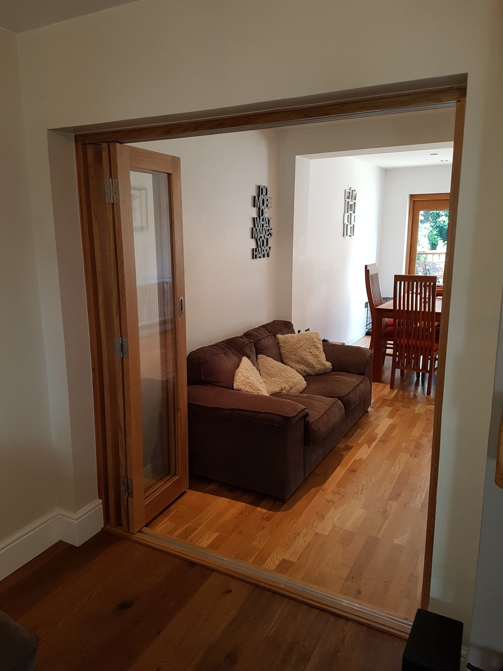 Oak bi-fold doors open.jpg