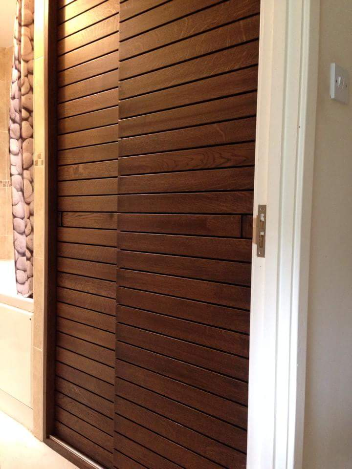 ebonised Oak bathroom sliding door airing cupboard.jpg