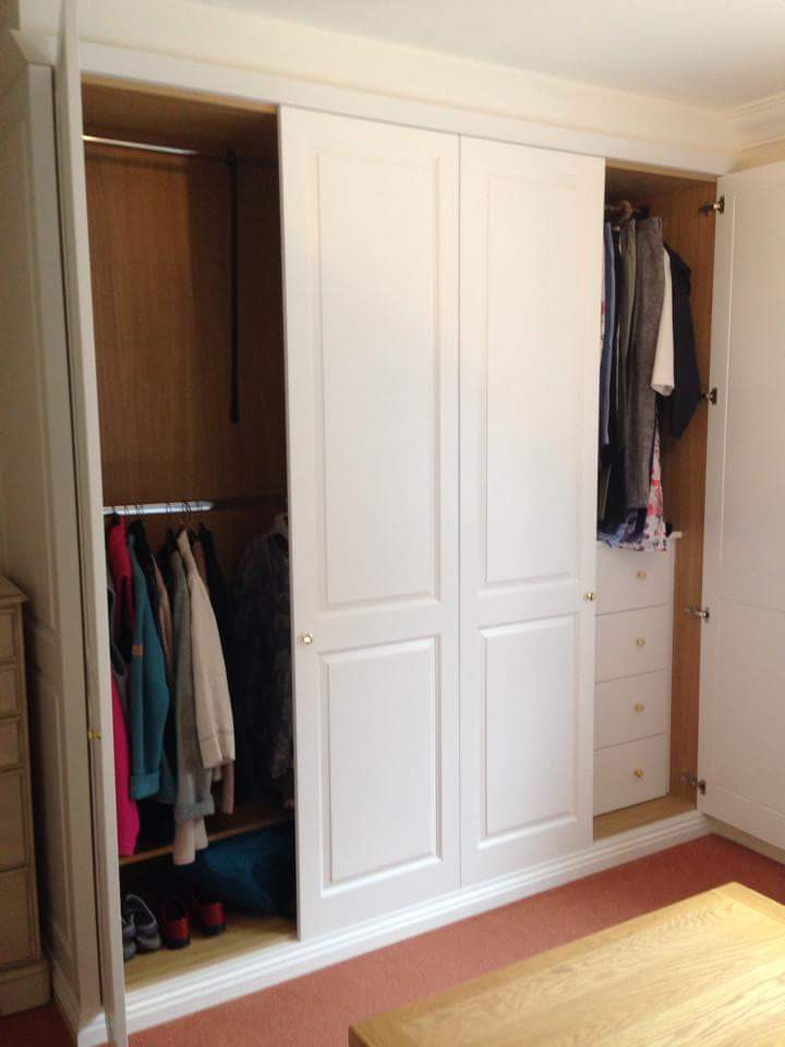 White wardrobe, with built in drawers and double hanging.jpg