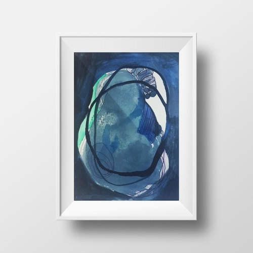 Blue abstract painting in a white frame.