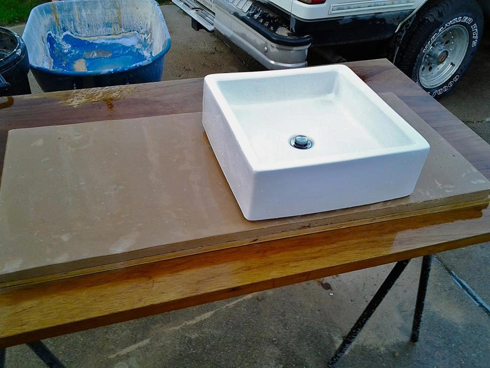 Cement bathroom counter top in progress. At this point we had removed the sides of the mold and completed wet grinding the surface.