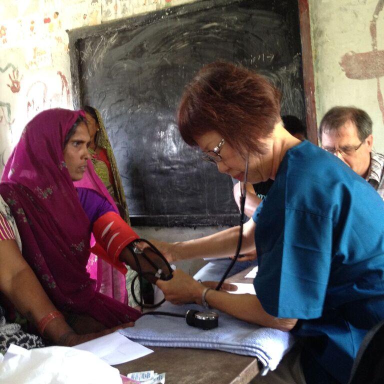 Nurse Faye checks blood pressure.jpeg