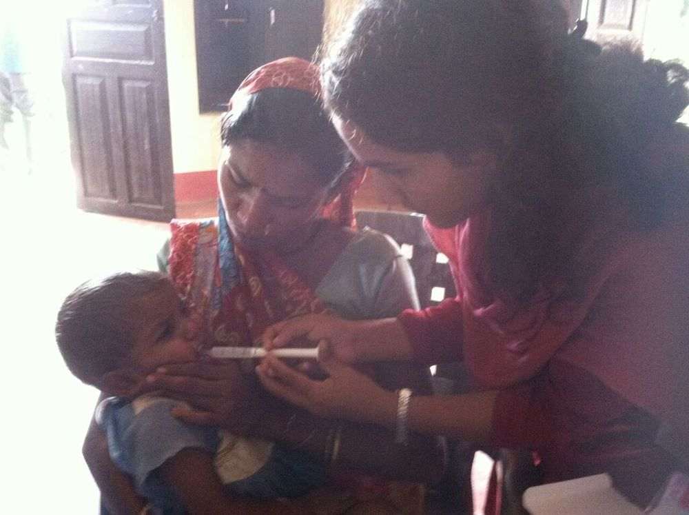 Sudharma, one of our ANM nuns, administers a dose.jpeg