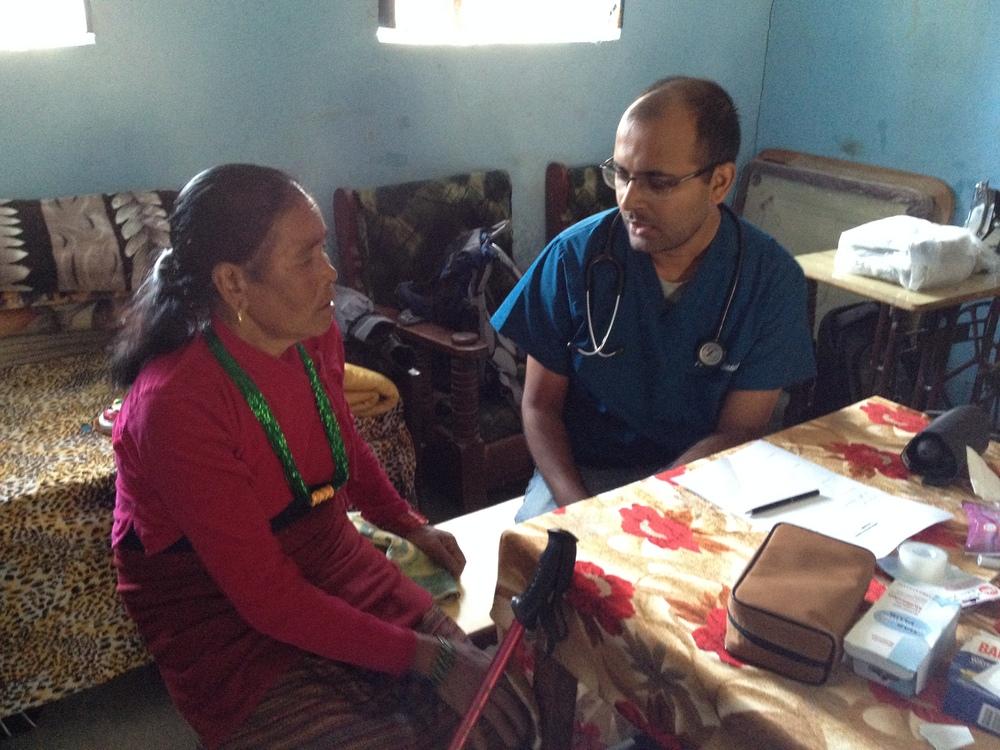 Bidur explains to a patient.JPG