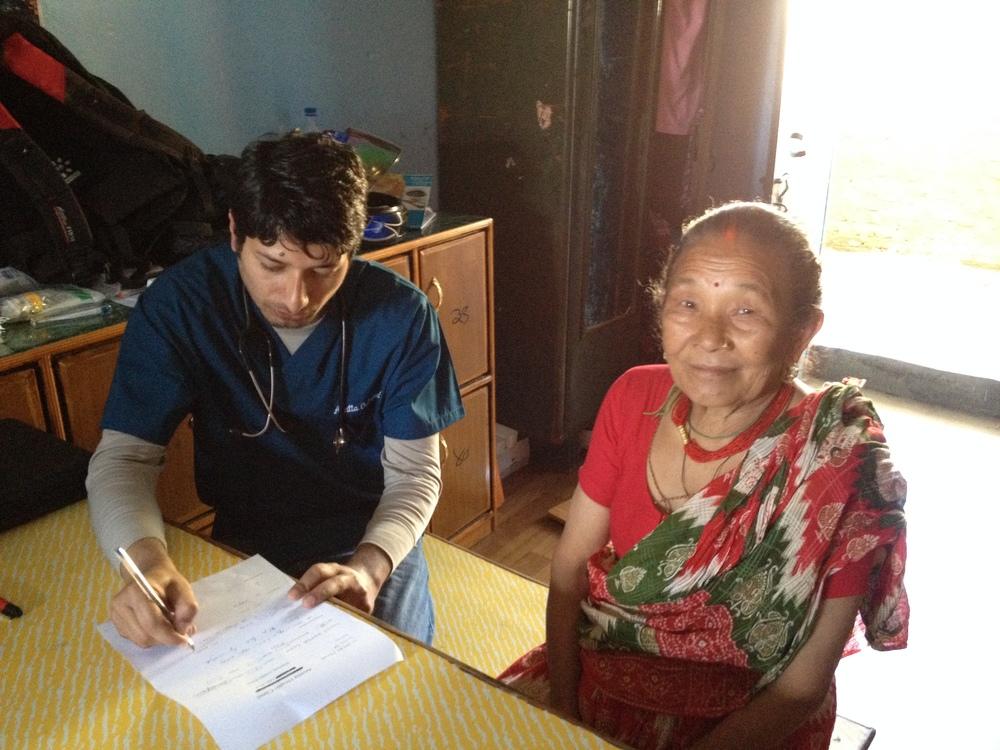 Raghu helps a happy woman.JPG