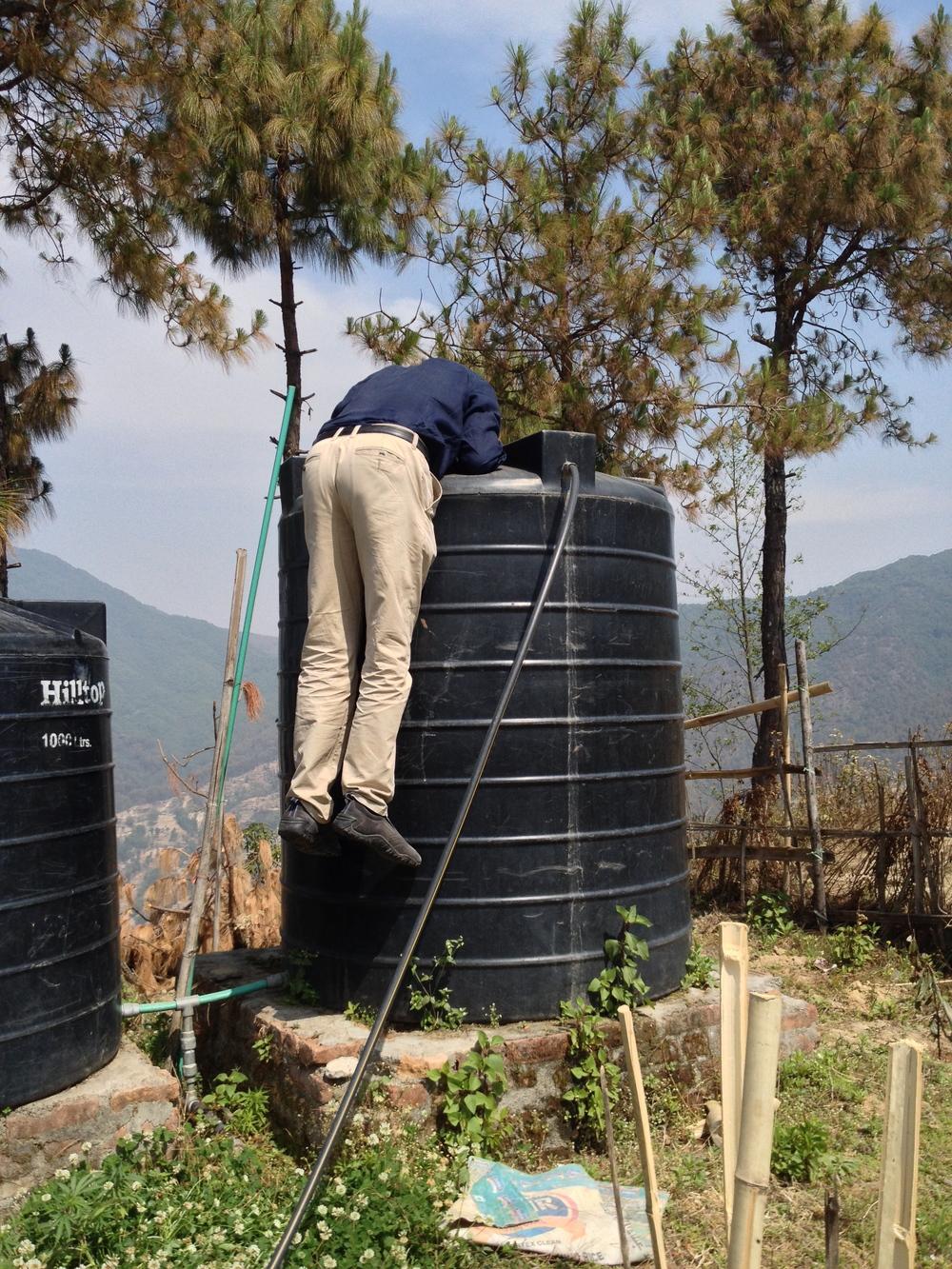 steve checks out the water tank problem.jpg