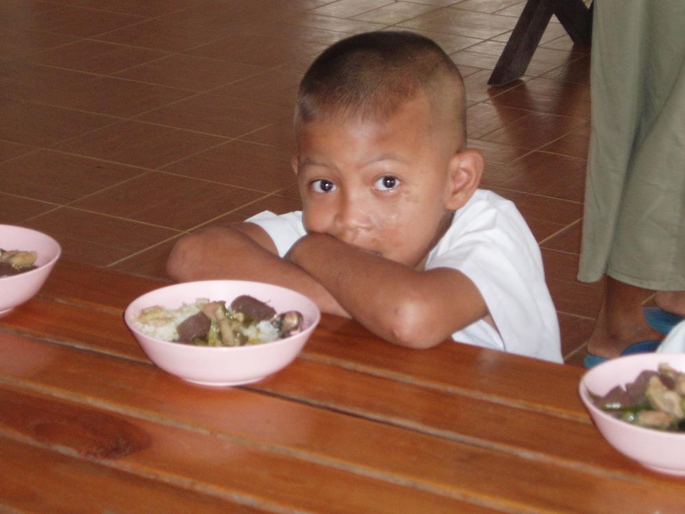HIV K boy at lunch.JPG