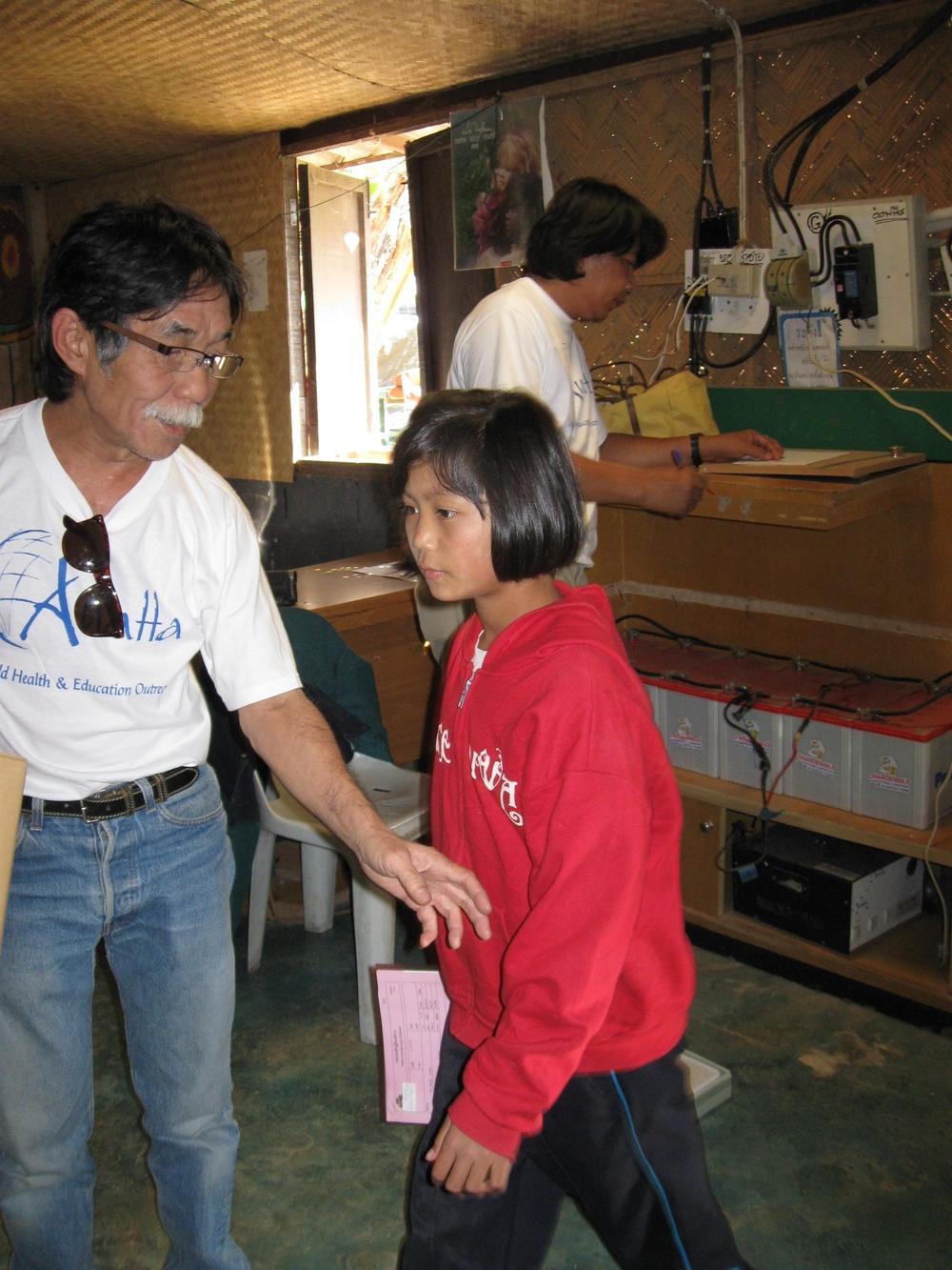 Pe Tang helping at clinic.JPG