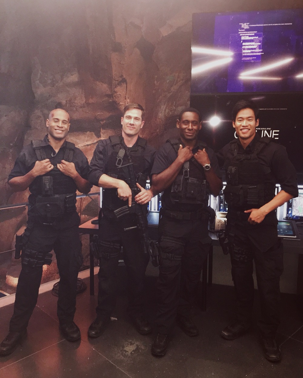 Actors Ayo Sorrells, Luke Macfarlane, David Harewood, and David Lim on the set of Supergirl