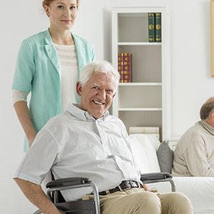 Older adult with caregiver living in an adult community
