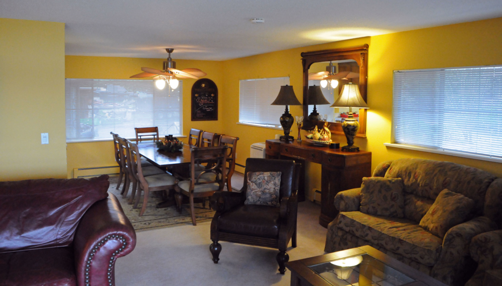 Maximum occupancy of 6. Living room with lake view, fireplace, private balcony with lake view, 2 bedrooms (1 king, 1 queen), 2 bathrooms, full kitchen, dining room, and 2 over stuffed chairs with pull-out twin beds in the living room.