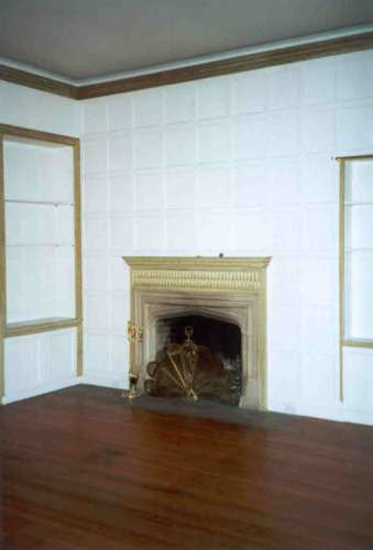 This is the same original room with the furniture removed. Note the size of the fireplace.