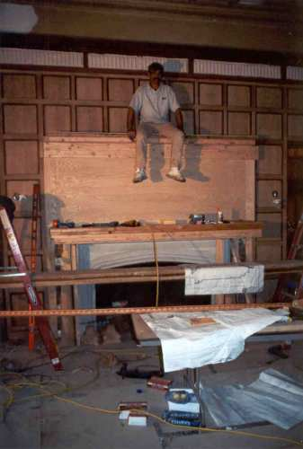 The giant fireplace mantel was reconstructed in place.