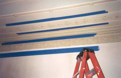 Some of the original ceiling moldings had been damaged over the last 90 years and needed to be restored. The first step was to mask off an original good area to be duplicated.