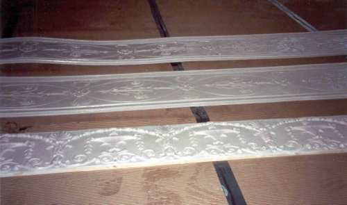The above molds were used to create these castings, seen here lying on the floor, ready to be installed.