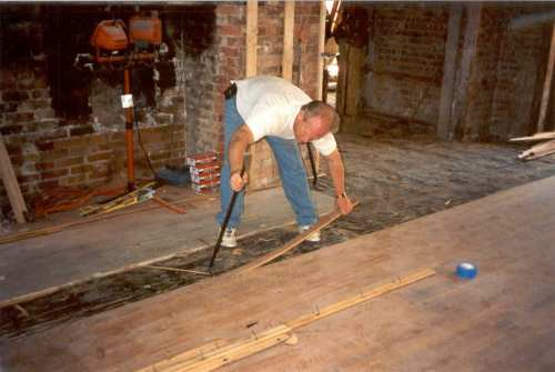 "The first step was to pry up the old floor. It was a beautiful floor of tiger (""quarter sawn"") oak of long lengths. The original nails used are no longer made, being the foundry-cast spikes. We have saved some for you to look at."