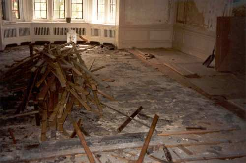 One of many piles of old floor, making a huge pile in total. Almost 4,000 square feet of old floor was removed.